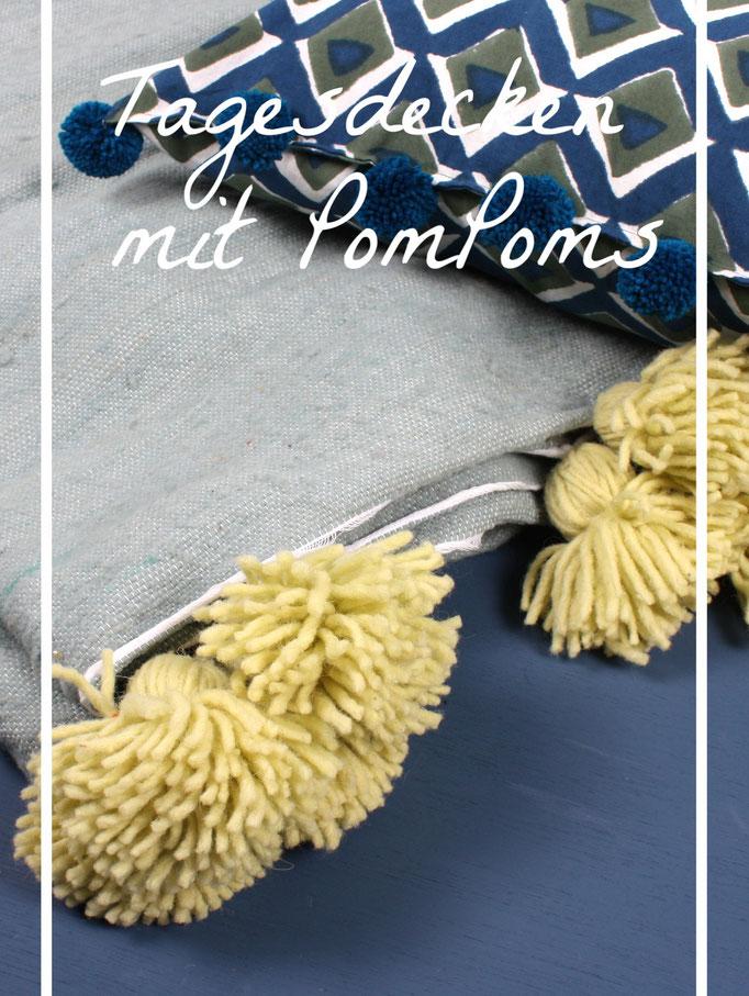 Plaids aus Wolle und Baumwolle mit Bommeln