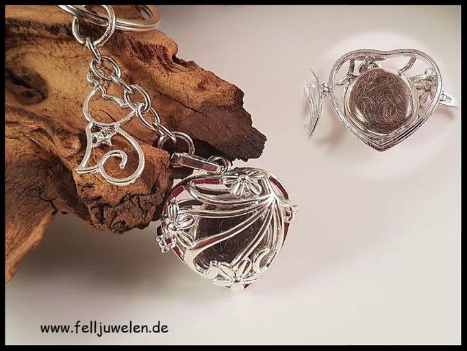 Bild 45: Flache Glasperle gefüllt mit Fell, eingelegt in einem Herzanhänger und einer angebrachten Katzensilhouette. Preis: 30 Euro