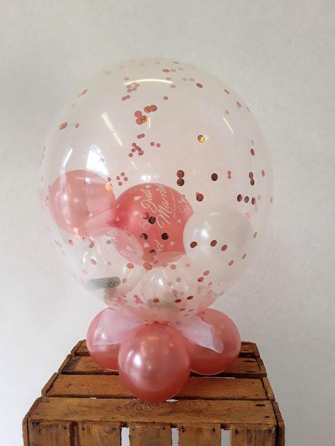 Glitzerkonfettiballon mit Ballonfuß und Geldkugel innen. Luftgefüllt, lange haltbar.