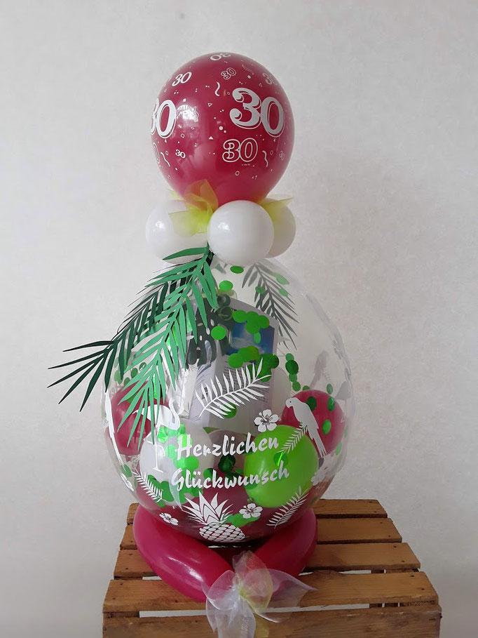 Verpackungsballon im tropischen Design. Mit Blättern, Papagei und Ananas zum 30. Geburtstag.