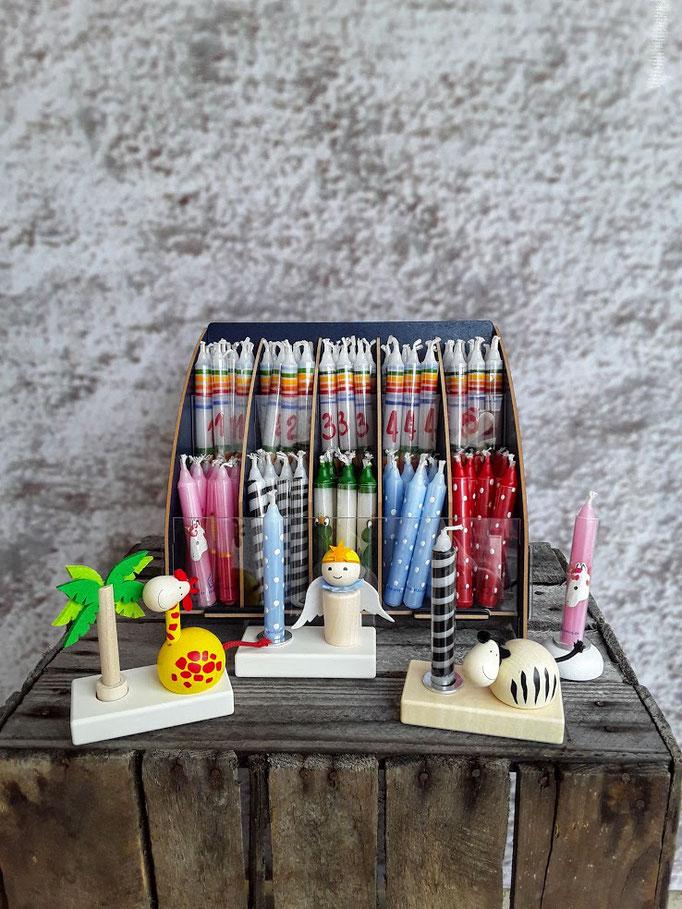Handgearbeitete Kerzen mit Zahlen und verschiedenen Themen. Der Hersteller bindet eine Lebenshilfe ein.