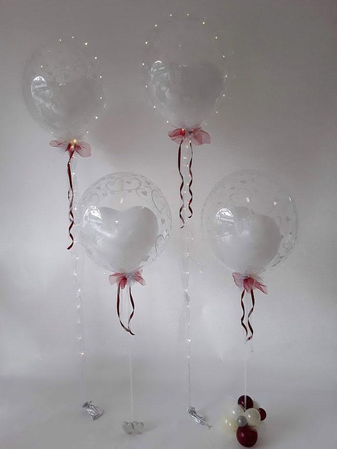 Durchsichtige, glasklare Bubble-Dekorationen mit Herz-Innenballon und exklusiver Schleife. Mit oder ohne Lichterkette.