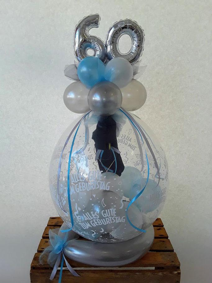Sechzigster Geburtstag: Ein Verpackungsballon als Geschenkidee mit besonderer Füllung. Was rein geht wird verpackt.