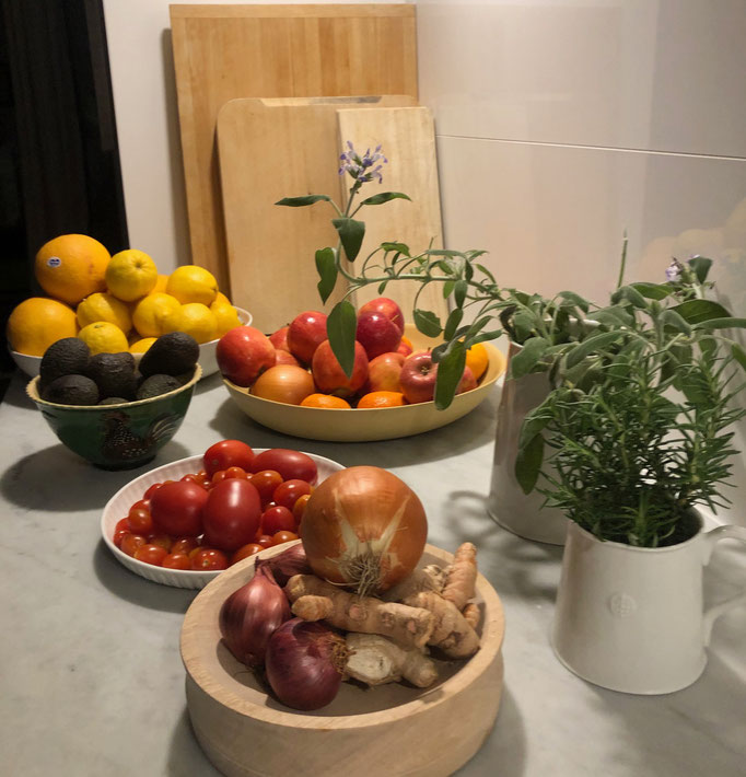 Carrara marble treated bench tops with wooden bowls for fruit & veg