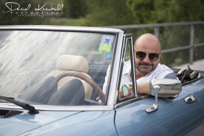 Sandro in seinem Alfa Romeo Spider