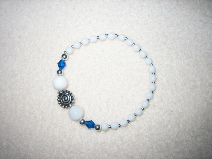 facettiertes Glas, versilberte Perle