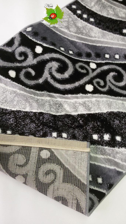 Tappeto moderno Lurex rettangolare 100x150 cm con disegno ondulare. B168