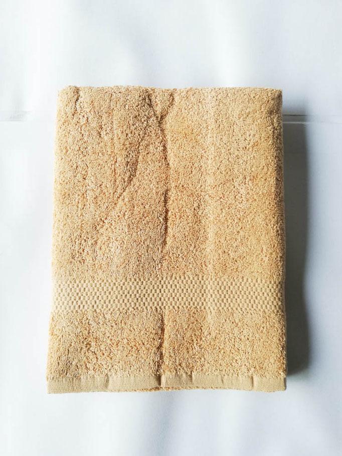 Asciugamano Liabel 1+1 asciugamano viso e ospite in spugna di cotone tinta unita. Col.Senape.B750