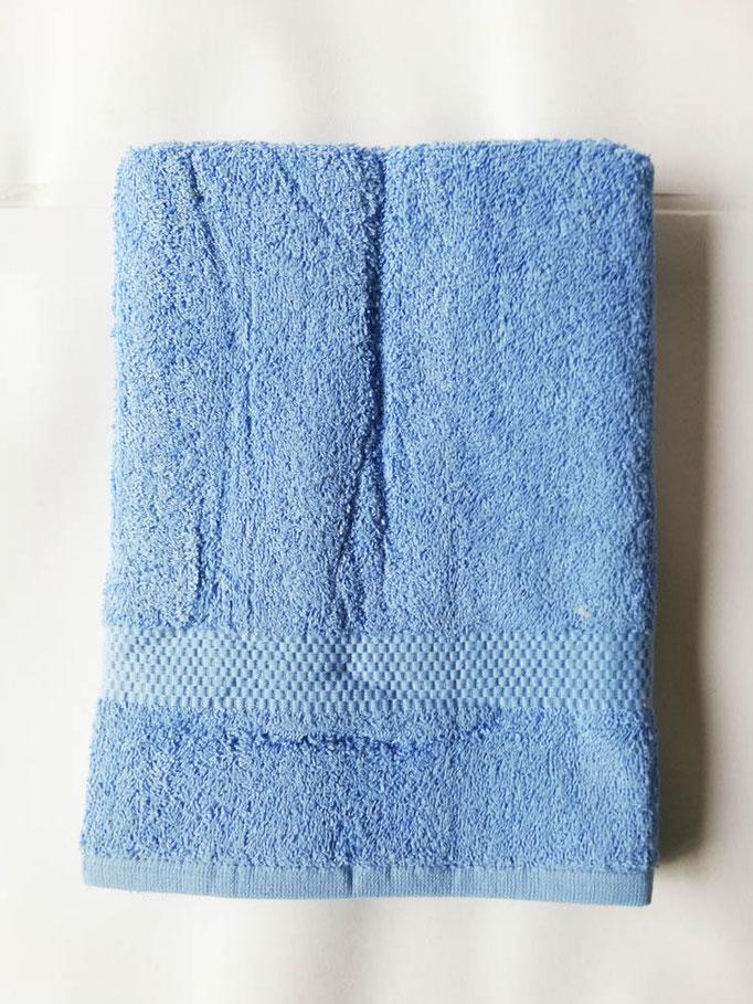 Asciugamano Liabel 1+1 asciugamano viso e ospite in spugna di cotone tinta unita. Col.Celeste.B750