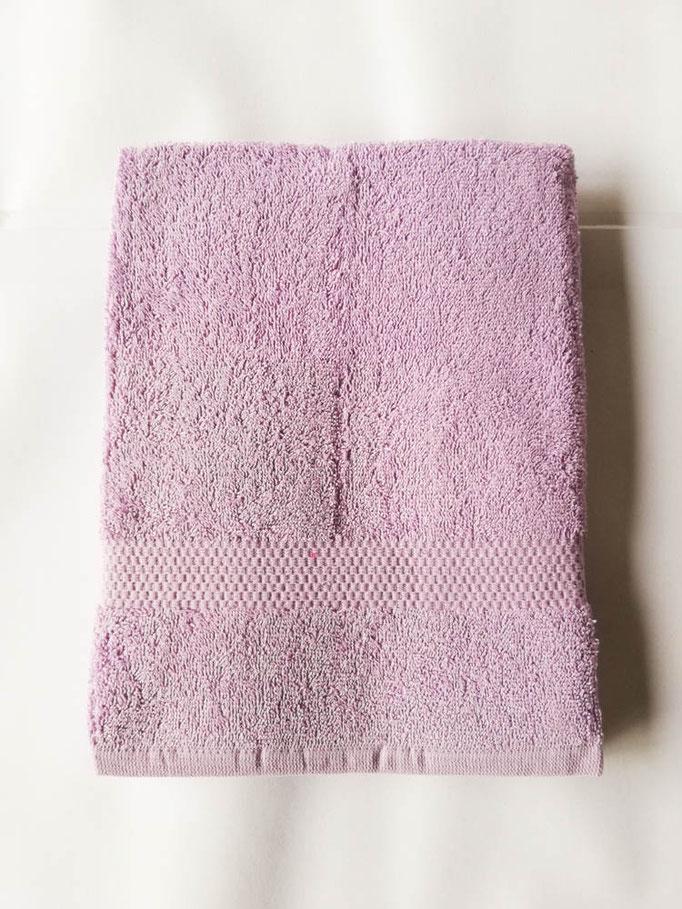 Asciugamano Liabel 1+1 asciugamano viso e ospite in spugna di cotone tinta unita. Col.Lilla.B750