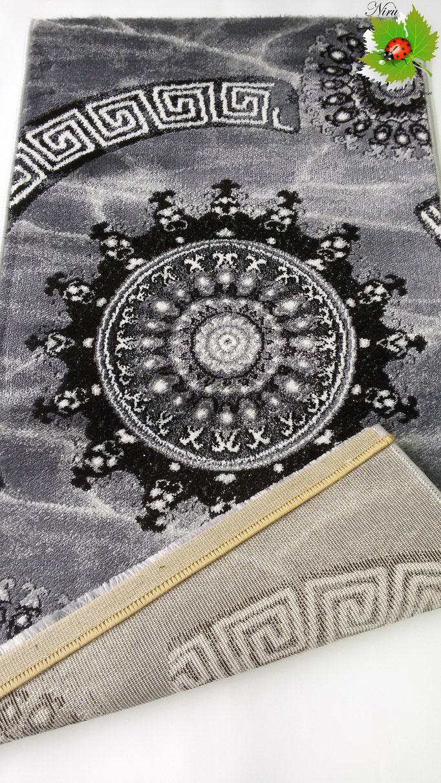 Tappeto moderno Lurex rettangolare 100x150 cm con disegno piazzato centrale. B189