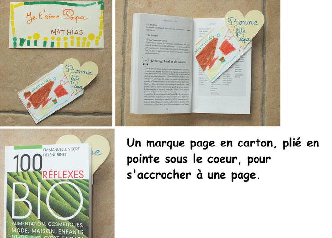 marque page en carton avec dessin de l'enfant, plié en pointe sous le coeur, pour la fête des pérs