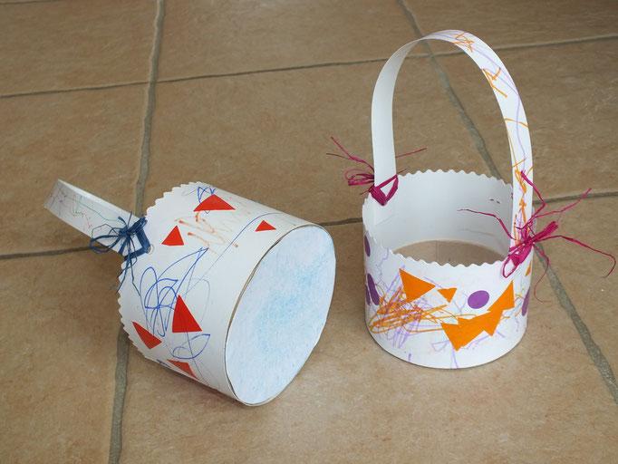 panier de Pâques à base d'une boite de camembert et carton; décor au crayon gras, feutre et gommettes