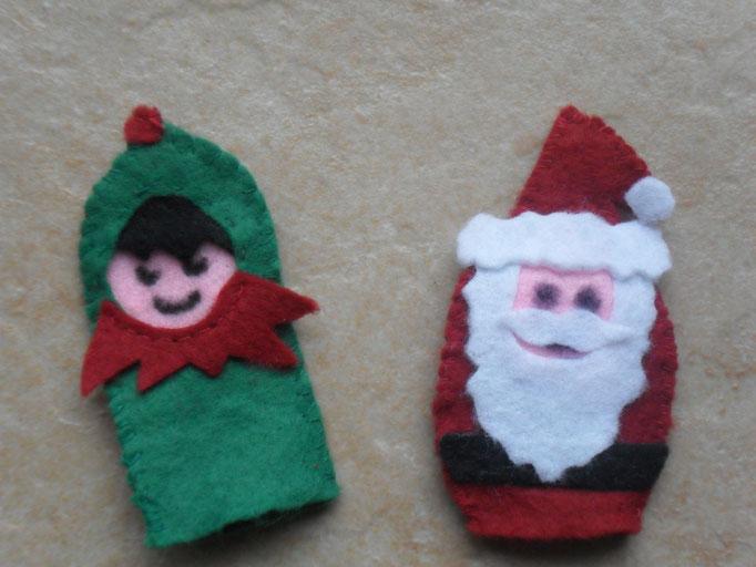 marionnettes de Noel en feutrine (réalisés en couture et avec de la colle) : Le  Père Noel et son Lutin qui resteront au RAM de Dormans, pour tous les enfants