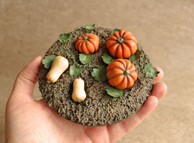 "Pumpkins. Material test. Polymer clay, polyurethane foam base with ""cork mud"", paper and wire for leafs."