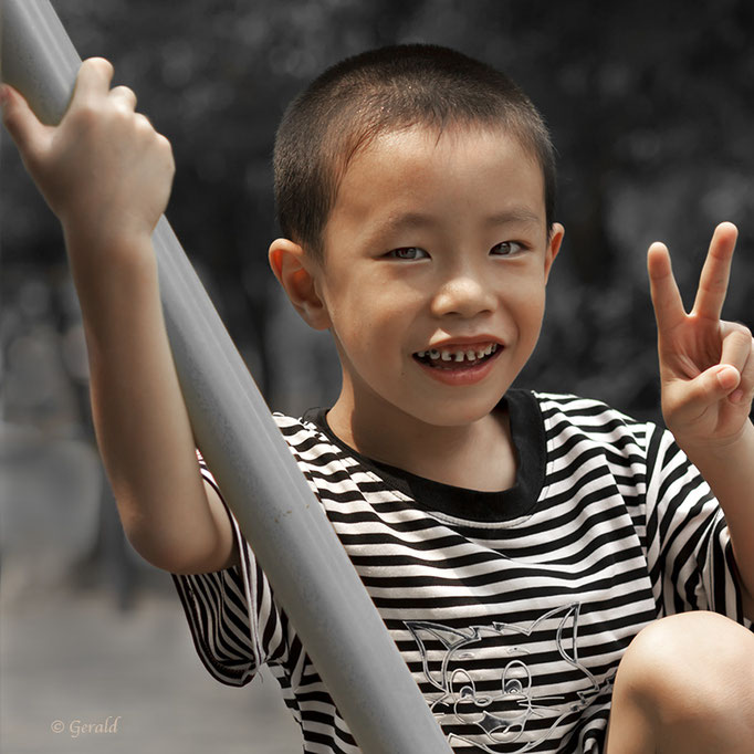 A chinese boy on a swing