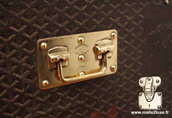 brass handle on goyard trunk