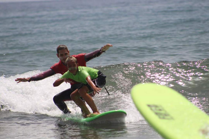 Instructor, student tandem surfing - wohoo