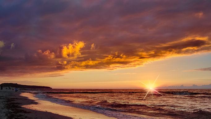 Sonnenuntergang am Strand von Warnemünde