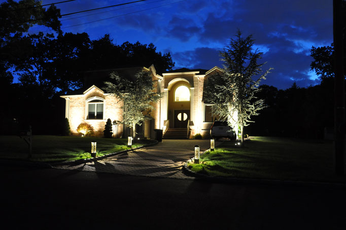 The lighting design objective was to draw the eye from low to high...from the driveway bollards, to the uplit trees, onto the wall-washed facade of the home. Woodcliff Lake, NJ