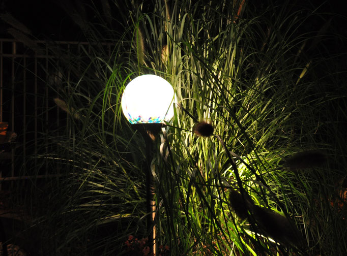"A hand-blown glass ""NightOrb"" appears to float as it is strategically placed within the tall grass. - Franklin Lakes, NJ"