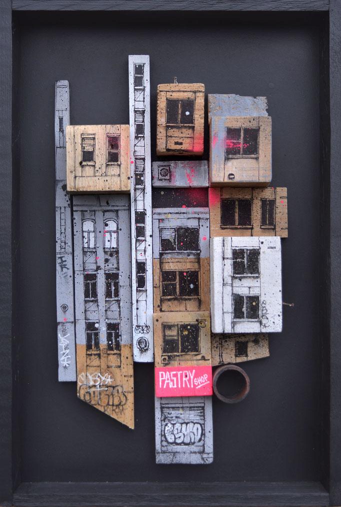 "<b>BLOC URBAIN</b><br>64 x 43 cm<br><a href=""https://www.graffmatt.com/contact/mail-tableau"" ; style=""color:#49bfc0;"" target=""_blank"">Disponible</a><alt=""art facade building newyork city sculpture graffiti painting volume art for sale french artist"">"
