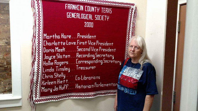 Standing next to the afghan she crocheted of the FCGS Officers at that time, is FCGS member Rhonda Morton, daughter of Nell Crowston.