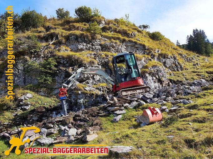 Spezialbaggerarbeit Adrian Krieg  Telefon 079 586 32 47 Gebirgsbau Bergbau alpiner Bau Hangsicherung Felsabbau Seilbahnfundamentbau Schneekanonenfundament Mastfundament Strasse Weg