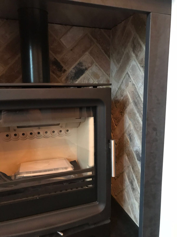 London Weathered Yellow fireplace chamber in Herringbone pattern.