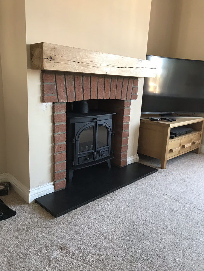 Durham Red Multi fireplace chamber with side returns and arched header