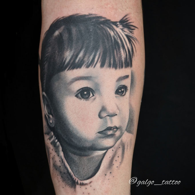 Realistic tatoo, daughter's portrait in black&grey. Canary Islands, Spain.