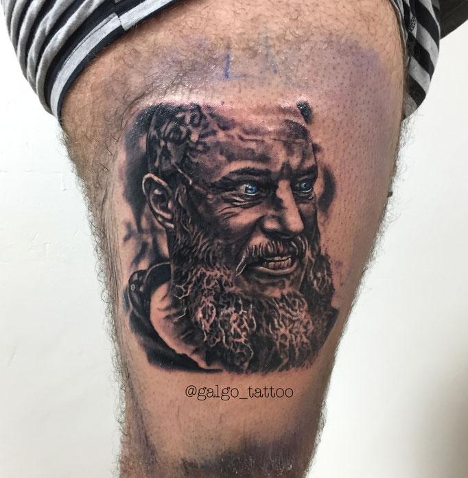 Realistic Ragnar portrait tattoo from Vikings tv show.