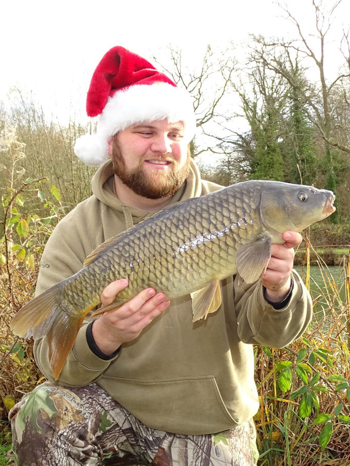 A Carp just over 9lb caught on the surface using bread crust. A Christmas Carp for Steve.