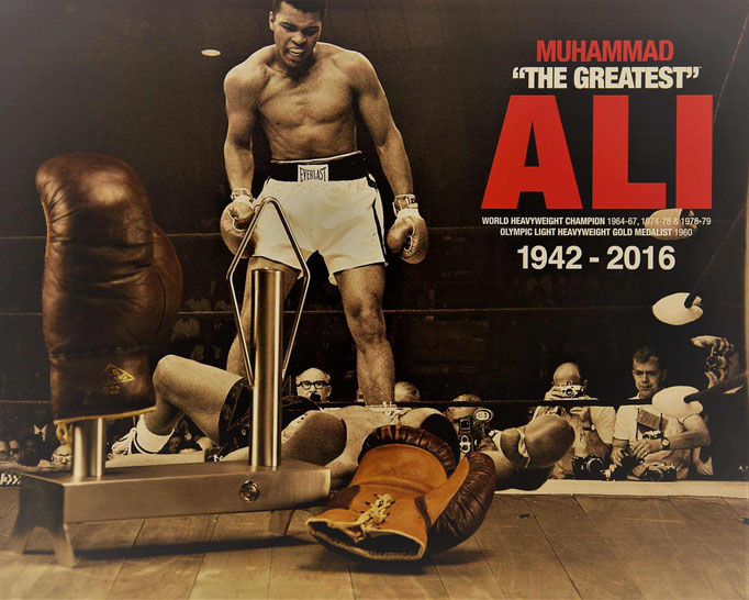 muhamad ali and vintage boxing gloves