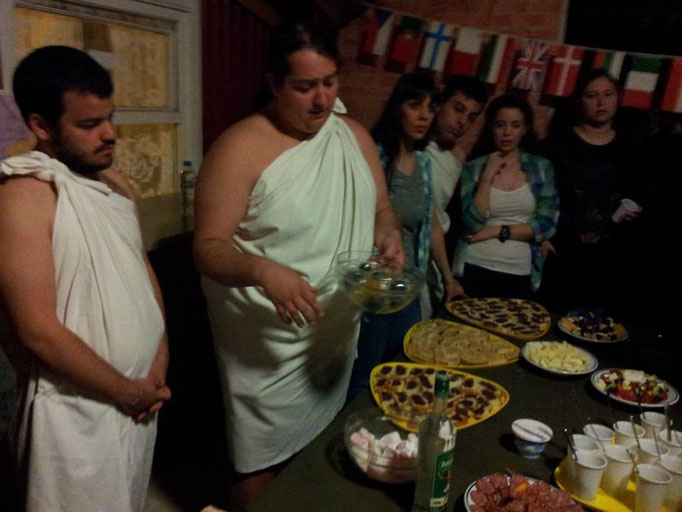 Greek participants sharing Greek traditional&tasty foods with other participants