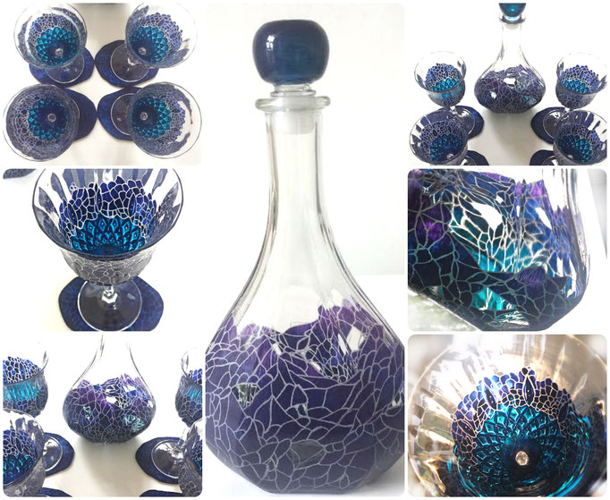 A set of four unique crystal hand engraved and painted glasses and carafe . With four matching unique hand carved and painted coasters . Inspired by the owners