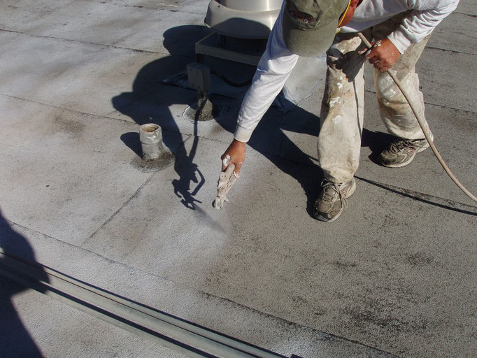 Spraying Ceramic InsulSeal on a Built-Up-Roof (BUR) membrane