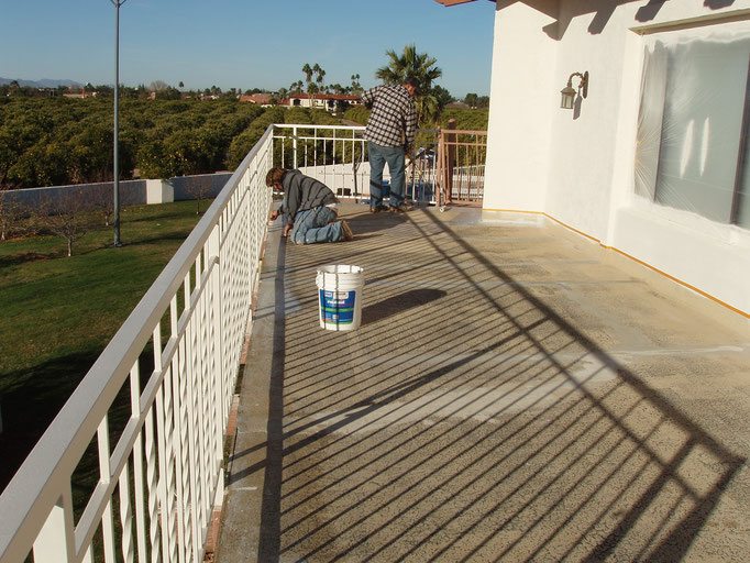 Brushing and rolling Ceramic InsulSeal around railing