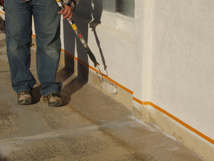 To prevent overspray the contractor chose to roll Ceramic InsulSeal along vertical wall trim