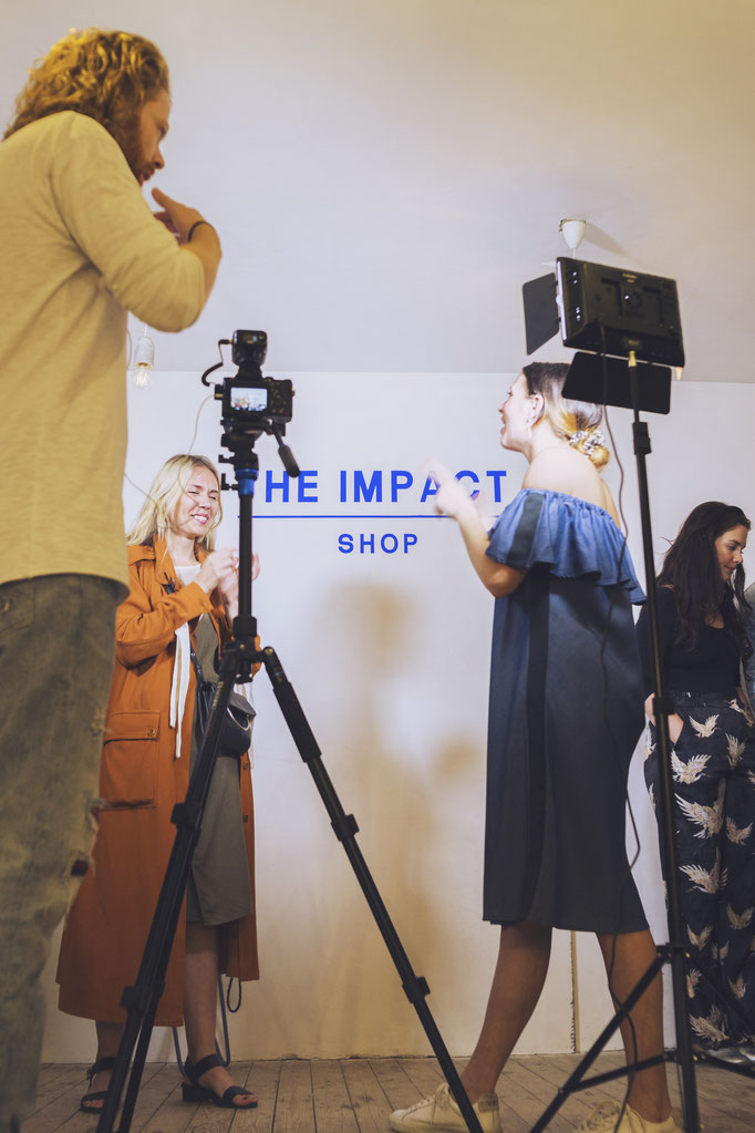Chanel Trapman is interviewing and filming video content at the opening of The Impact Shop. Photo by photographer Landa Penders in Amsterdam