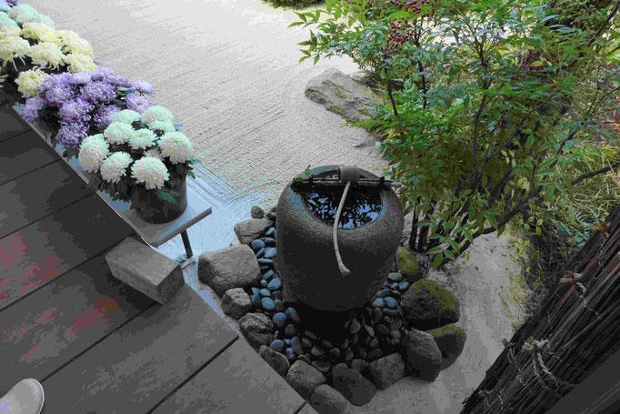 Brunnen mit Schöpfkelle