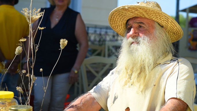 Vassili, the Weed King of Kythera, and his stand at the Sunday markets.