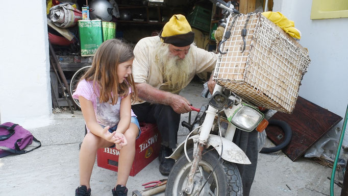 Old Vasilis and his granddaughter Marianthi working on various problems simultaneously.