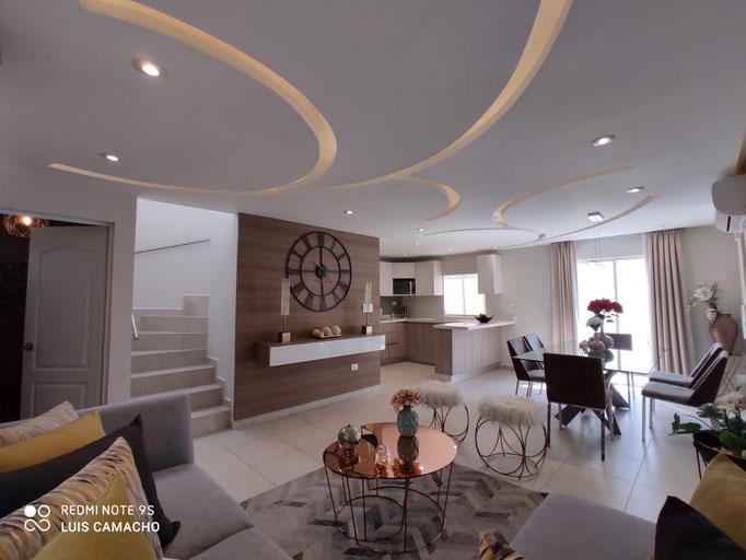 Comedor y sala de casa modelo veneto, arezzo residencial, dominio cumbres