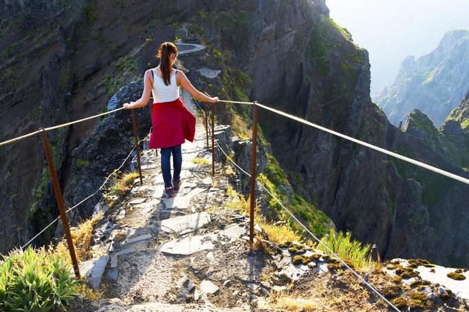 Young girl on the winding mountain trekking path at Pico do Areeiro, Madeira, Portugal Copyright Mikadun