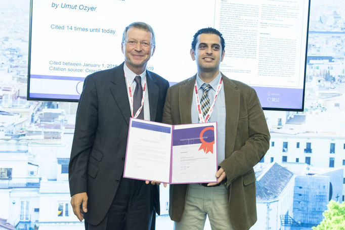 Most Cited Article: Scientific Paper, from left to right: K. Hausegger (CVIR EiC) and U. Ozyer (awardee)