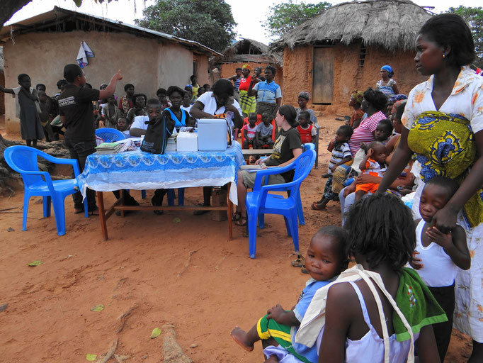 Village people listen to explanations about malaria.