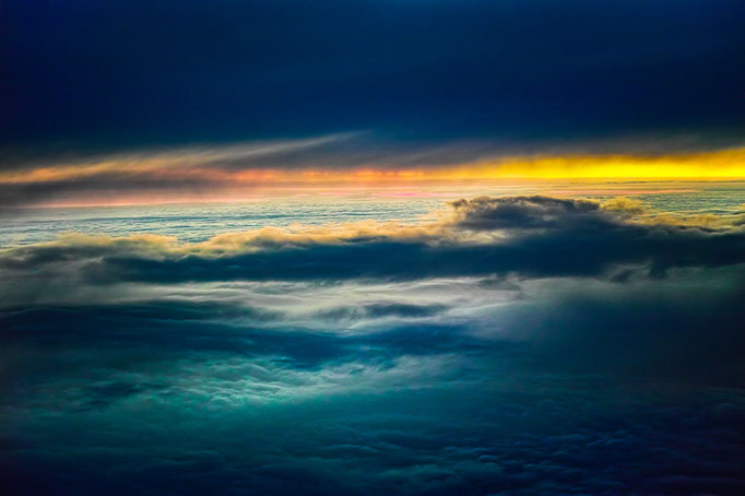 Sunset above the clouds, flight from Kopenhagen to Stuttgart