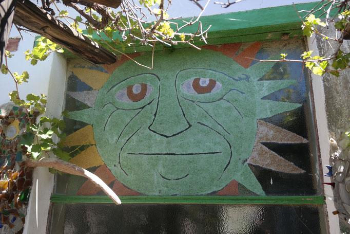 A sun painted onto a window, Owl House, Nieu-Bethesda, South Africa.