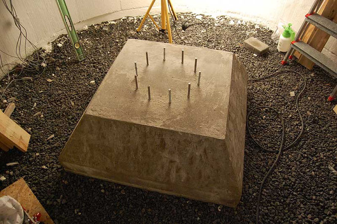 With the formwork removed, a truncated pyramid concrete footing is revealed.